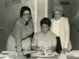 Sister Mary Glennon, Sister Mary Carmel Mcgargile, and Sister Mary Sharon Gallagher pose for photo together in Mercy Hall 1994